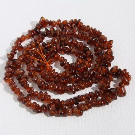 Hesszonit gránát ásvány splitter / szemcse - gömbölyített szemű - kb. 85cm-es szál