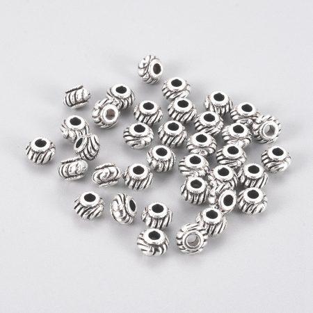 Tibeti stílusú fém köztes - antik ezüst színű 4,5x6mm-es rondell, furat: 2,3mm
