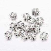 Tibeti stílusú fém köztes - antik ezüst színű 7x3mm-es virág, furat: 1,5mm