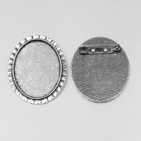 Ragasztható kitűző alap 48x38mm átmérőjű - antik ezüst színű, 40x30mm-es kabosonhoz