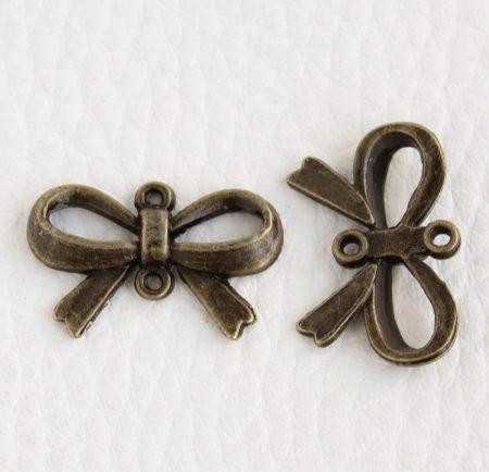 Tibeti stílusú összekötő elem - antik bronz színű 15x22mm-es masni