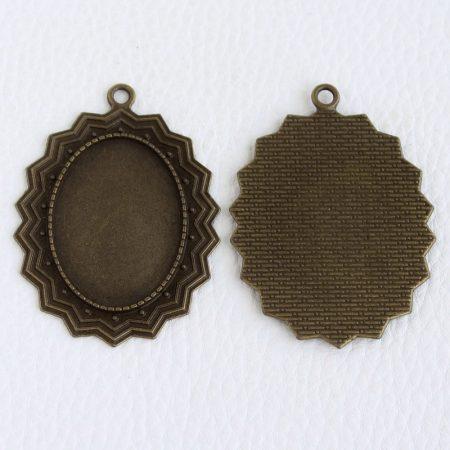 Tibeti stílusú ragasztható fém medál alap - antik bronz színű 55x40mm-es, 35x25mm-es kabosonhoz