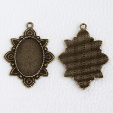 Tibeti stílusú ragasztható fém medál alap - antik bronz színű 52x38mm-es, 30x20mm-es kabosonhoz