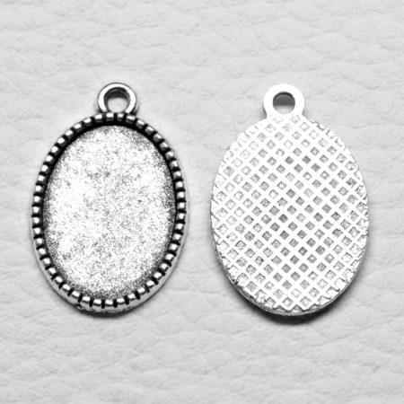 Tibeti stílusú ragasztható fém medál alap - antik ezüst színű 24x15mm-es, 18x13mm-es kabosonhoz