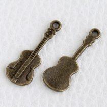 Tibeti stílusú fém medálka / fityegő - antik bronz színű 27x10mm-es hegedű