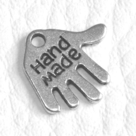"""Tibeti stílusú fém medálka / fityegő - antik ezüst színű 12x13mm-es kéz """"Hand Made"""""""