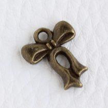 Tibeti stílusú fém medálka / fityegő - antik bronz színű 16x12mm-es masni